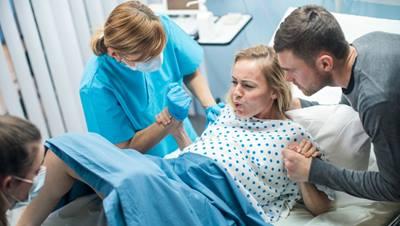 Woman giving birth naturally