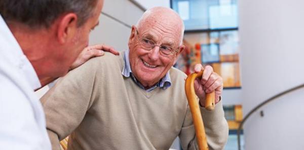 Older gentleman speaking to a physician.