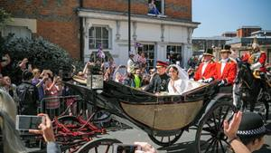 Prince Harry and Meghan Markle in a carriage